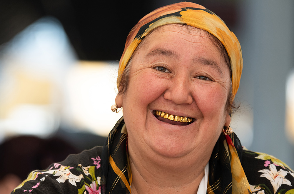 Uzbekistan old woman smiling with gold teeth