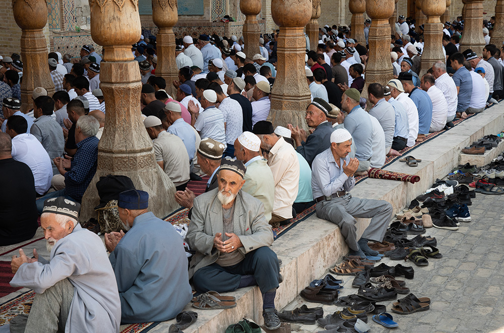 Uzbekistan men praying Bolo Hauz mosque in Bukhara