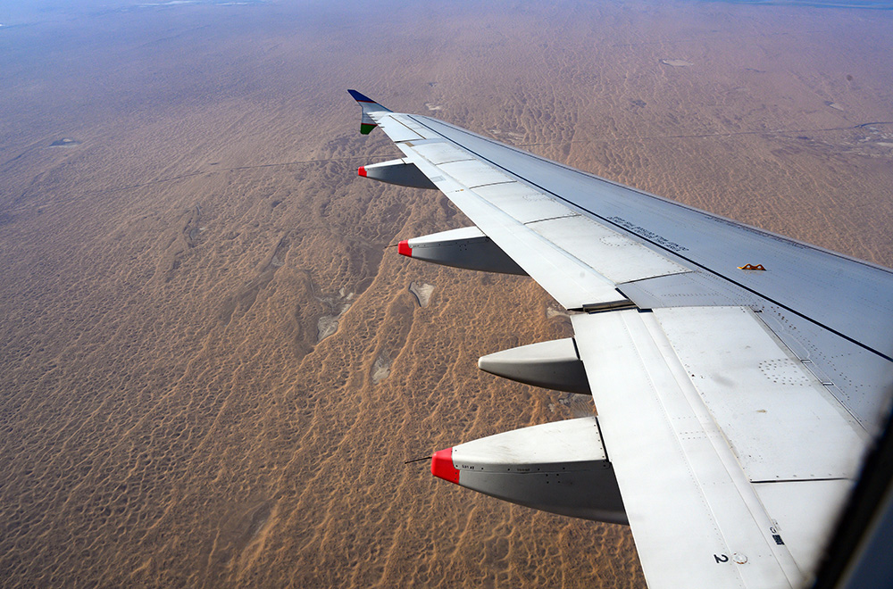 View from airplane flying from Tashkent to Urgench Uzbekistan over desert