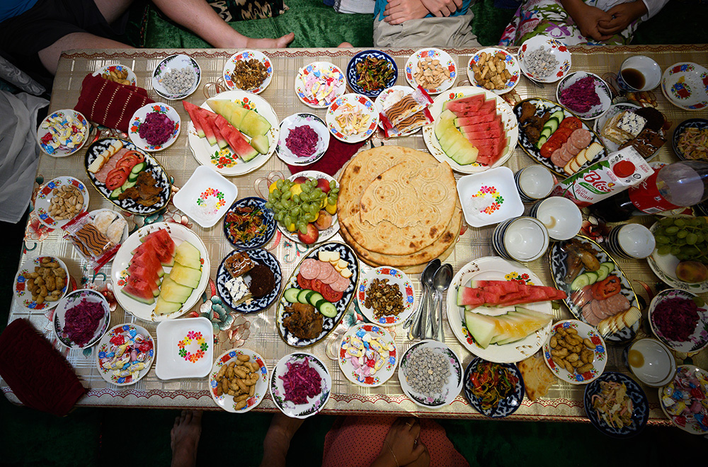 aerial photo of food at a familys table for a party in Uzbekistan