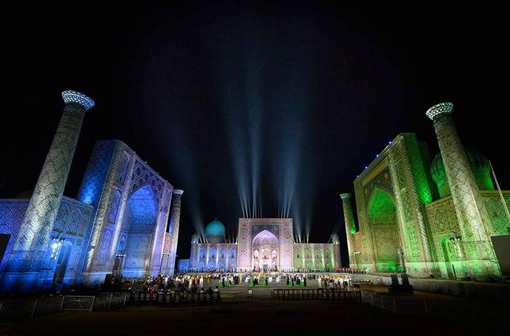 The Registan in Samarkand Uzbekistan lit up in blue green and white for a music festival