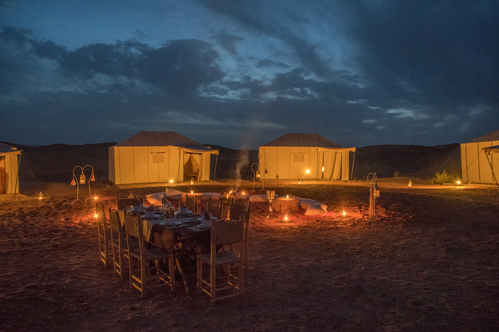 luxury tent camp in the Sahara desert at night - Morocco