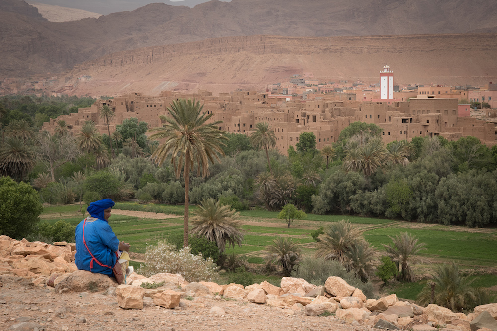 man looking over ancient village in Morocco