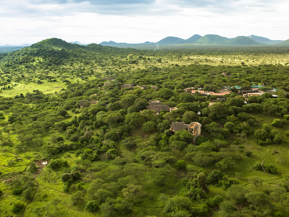 aerial view of luxury private tent safari camp Great Plains Ol Donyo in green jungle of Kenya