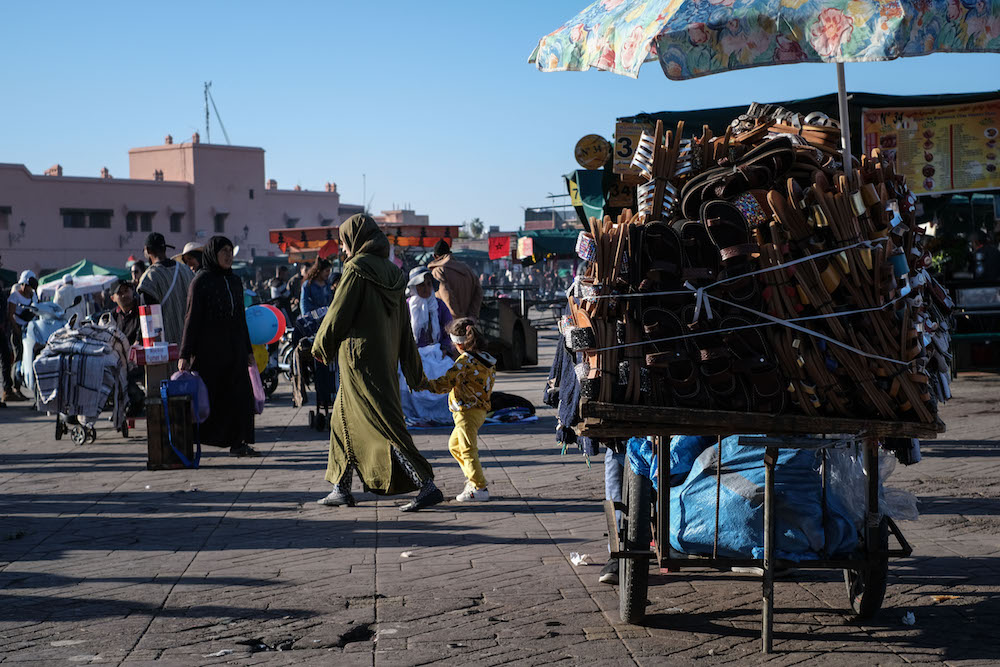Morocco Djemaa-el-Fnaa market square with people