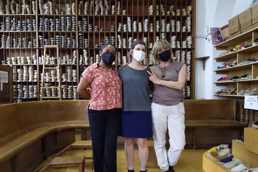 3 women posing at La Manual Alpargatera, oldest espadrilles shop in Barcelona