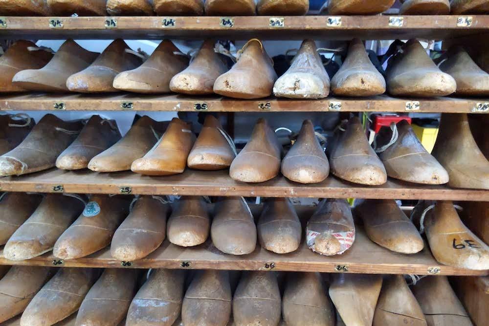 shoe molds on shelf at La Manual Alpargatera, oldest espadrilles shop in Barcelona