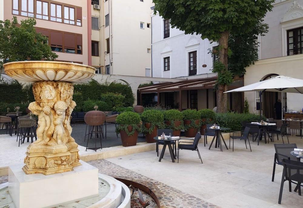 Madrid Spain hotel breakfast garden Palacio de los Duques Gran Meliá