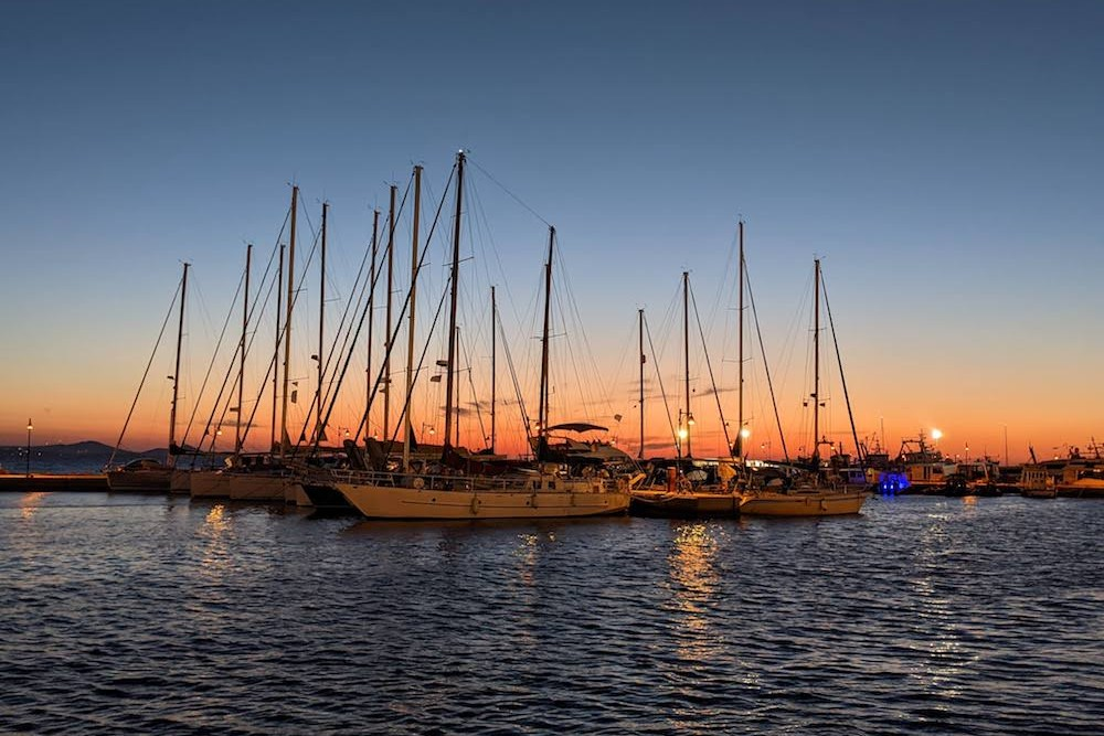 sunset over sailboats Naxos Town Greece