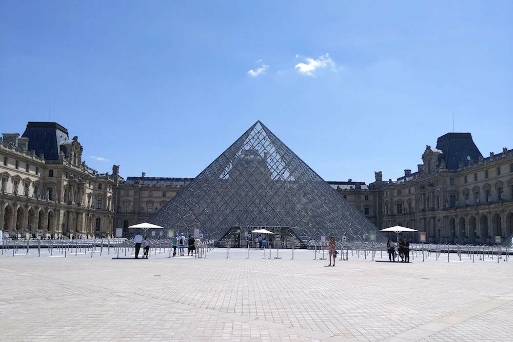 Paris Louvre pyramid plaza empty right after Paris reopening after covid lockdown