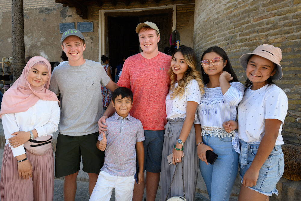 american teenage boys with family in Khiva Uzbekistan - making friends while traveling