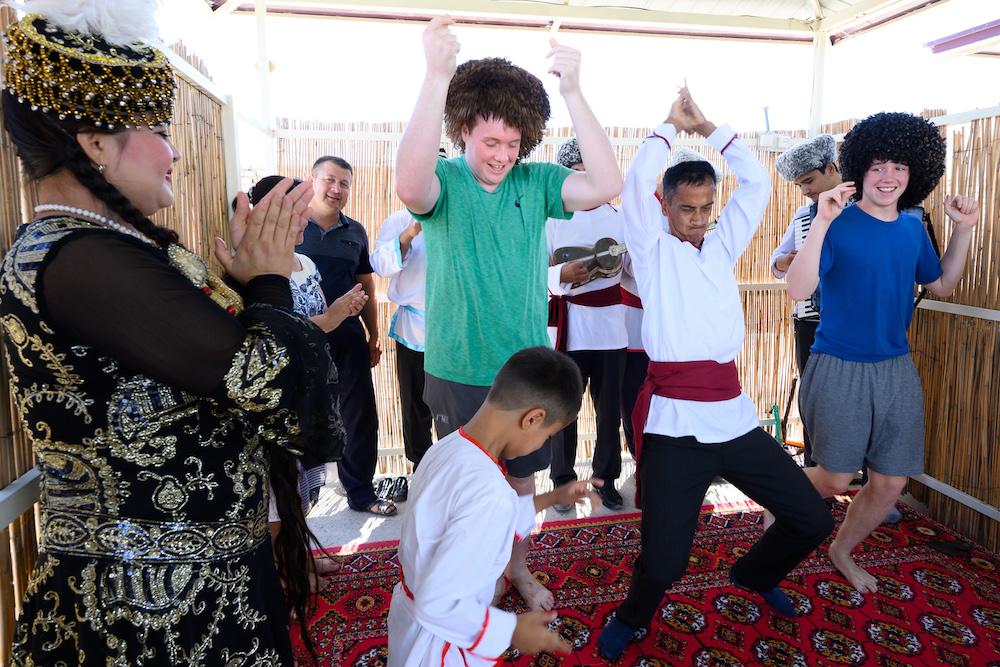 american teenage boys learning to dance in Khiva Uzbekistan