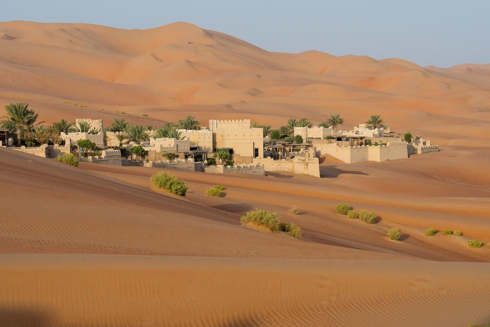 white buildings of Qasr al Sarab resort in Abu Dhabi desert