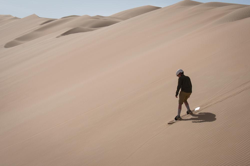 sandboarding in Abu Dhabi desert