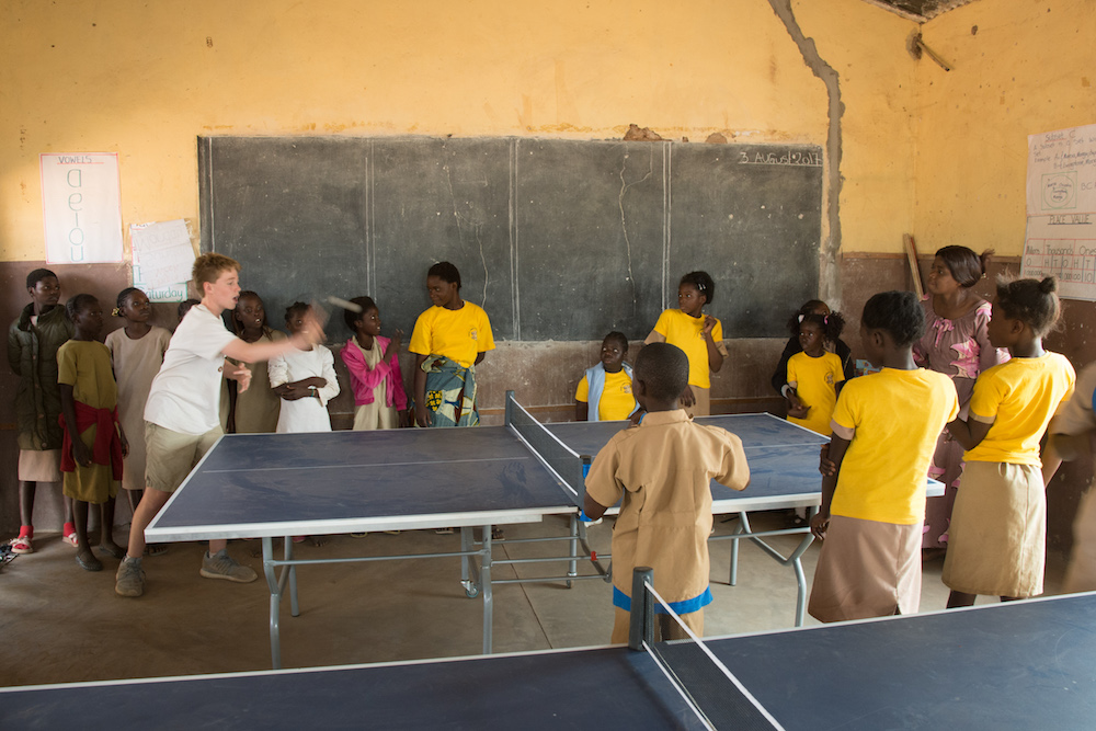 kids playing ping pong at a school in Chiawa Zambia
