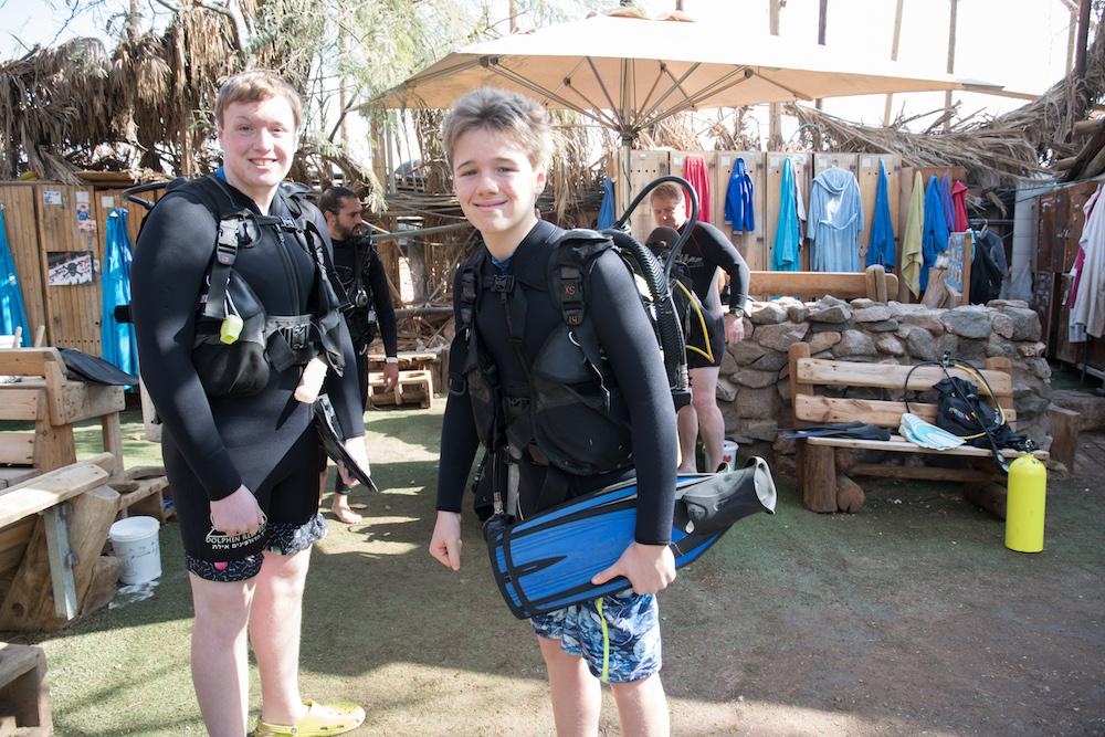teenage tourist boys in scuba gear in Eilat Israel