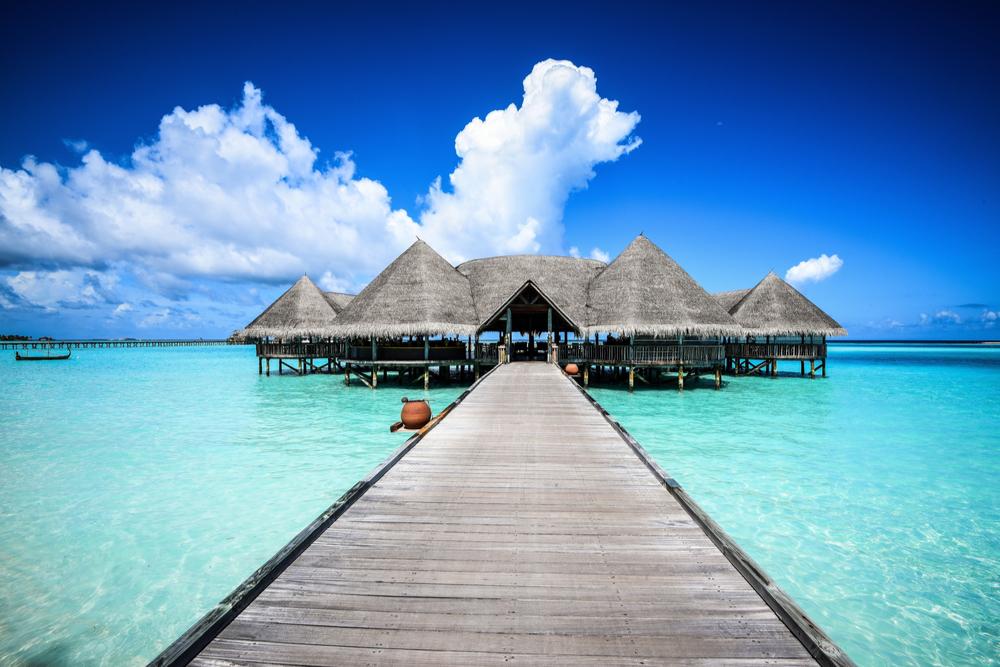 Beautiful beach landscape with overwater bungalows Gili Lankanfushi in the Maldives